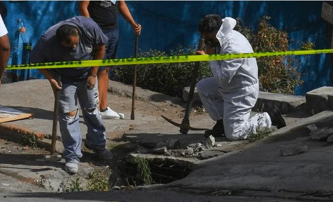 Encuentran restos de mujer en coladera de Naucalpan, Estado de México