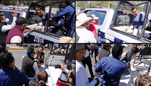 Escolta saca arma en plena protesta por cancelación de vacunación en Oaxaca (Video)