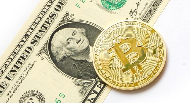 Wall Street en baja al mediodía por caída de Bitcoin